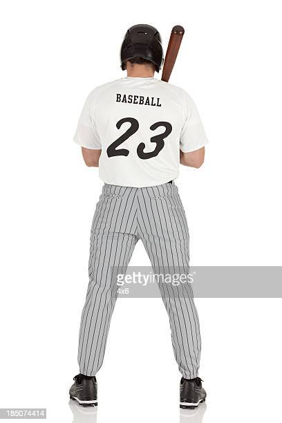 Rear view of a baseball player