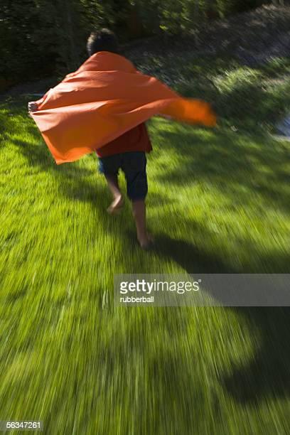 Rear view of a boy wearing a cape