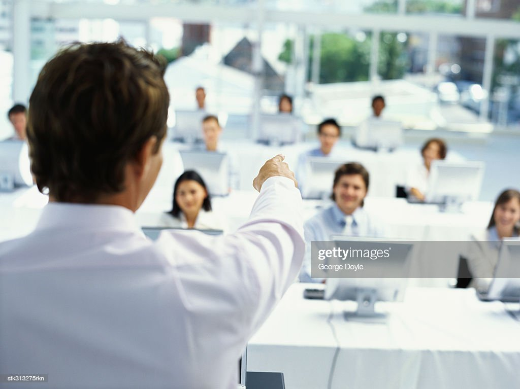rear view of a businessman training business executives at a seminar
