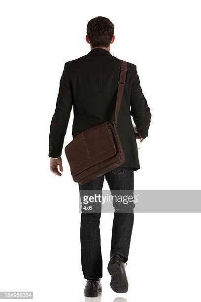 Rear view of a businessman walking