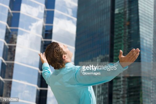 Rear view of a businessman with his arms outstretched : Foto de stock