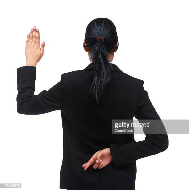 Rear view of a businesswoman crossing fingers