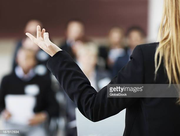 Rear view of a businesswoman giving presentation