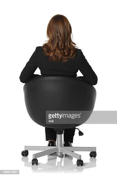 Rear view of a businesswoman sitting in chair
