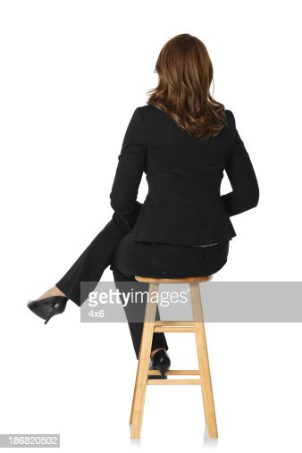 Rear View Of A Businesswoman Sitting On Stool Stock Photo Getty Images