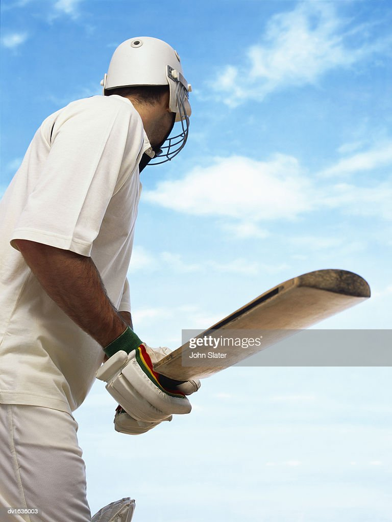 Rear View of a Cricket Player : Stock Photo
