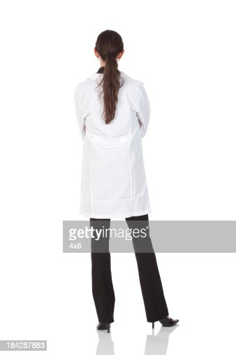 Rear view of a female doctor standing with arms crossed