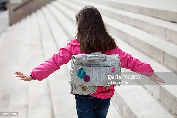 Rear view of a girl walking on the steps