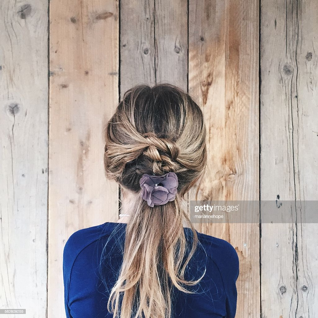 Rear view of a girl with flower in her hair : Stock Photo