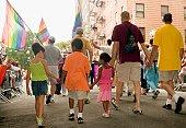 Rear view of a group of people walking at a gay parade