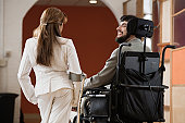Disabled businessman talking with a businesswoman