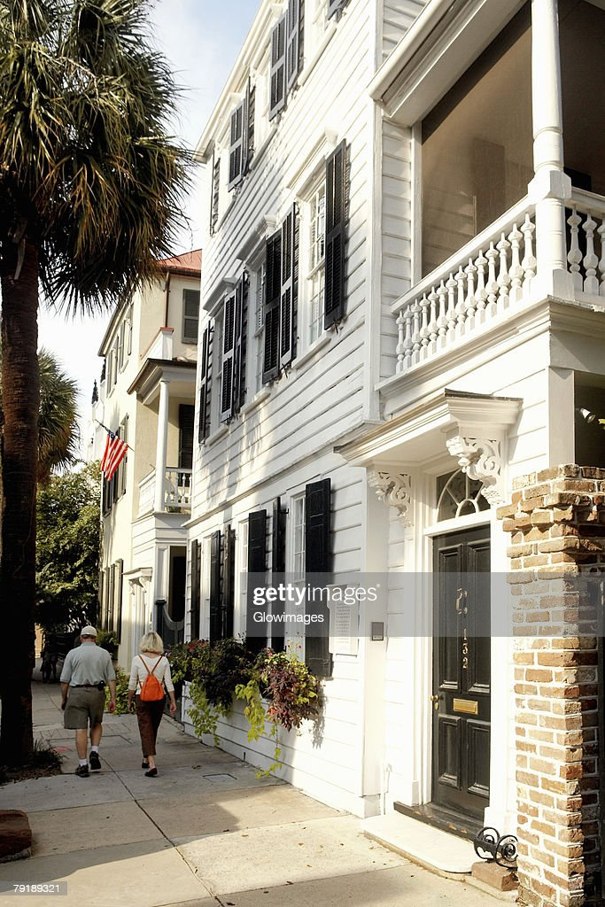 Rear view of a man and a woman walking on the street, Charleston, South Carolina, USA : Foto de stock
