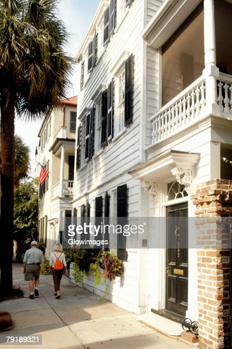 Rear view of a man and a woman walking on the street, Charleston, South Carolina, USA : Foto de stock