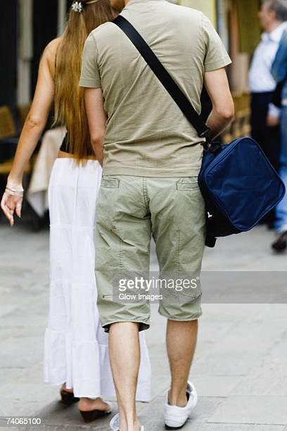 Rear view of a man and a woman walking