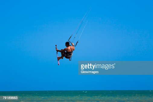 Rear view of a man kite boarding, Smathers Beach, Key West, Florida, USA : Foto de stock