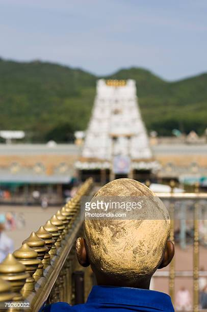 'Rear view of a man with his head covered with sandalwood paste, Tirupati, Tirumala Venkateswara Temple, Tirumala, Andhra Pradesh, India'
