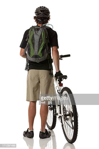 Rear view of a man with mountain bike