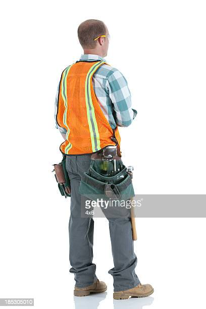 Rear view of a manual worker standing