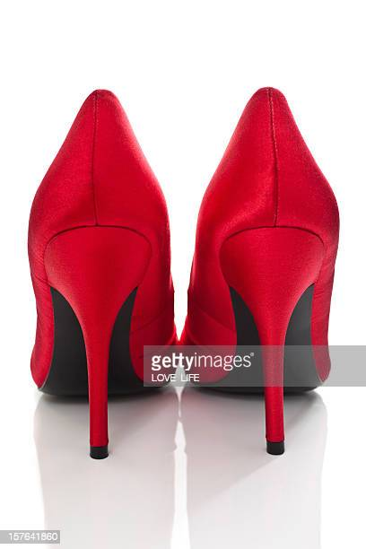 Rear view of a pair of red high-heeled shoes