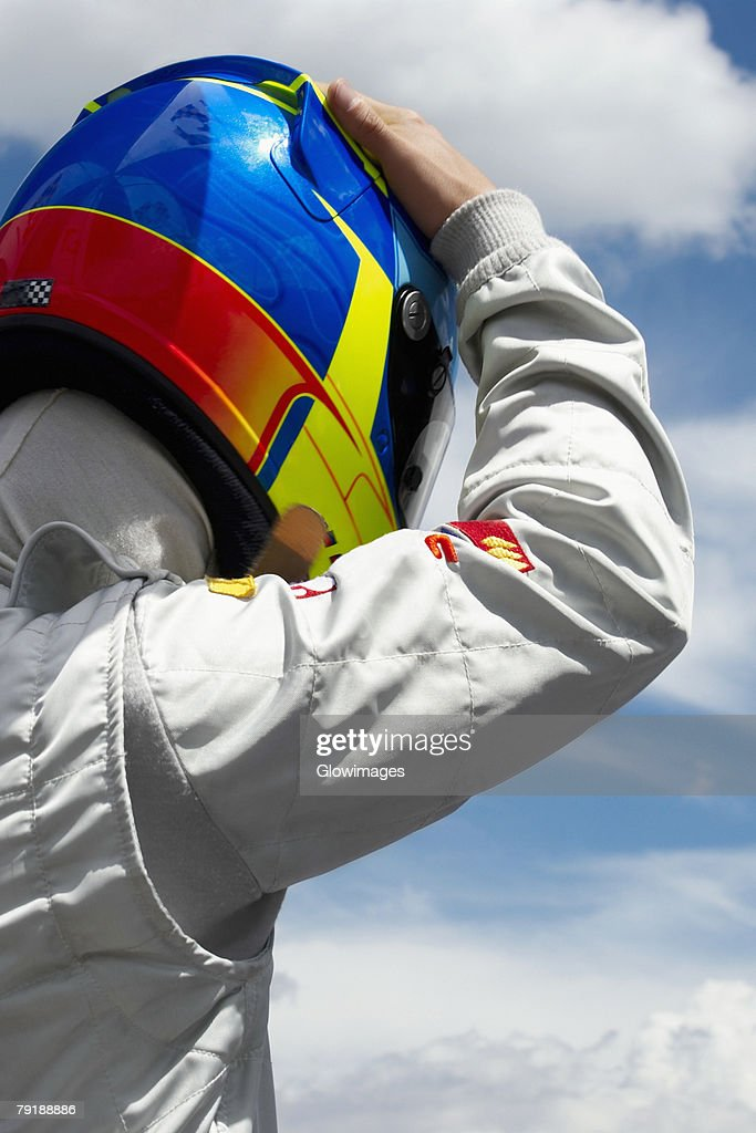 Rear view of a racecar driver : Foto de stock