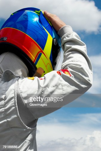 Rear view of a racecar driver : Stock Photo