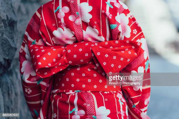 Rear view of a red kimono with red obi bow