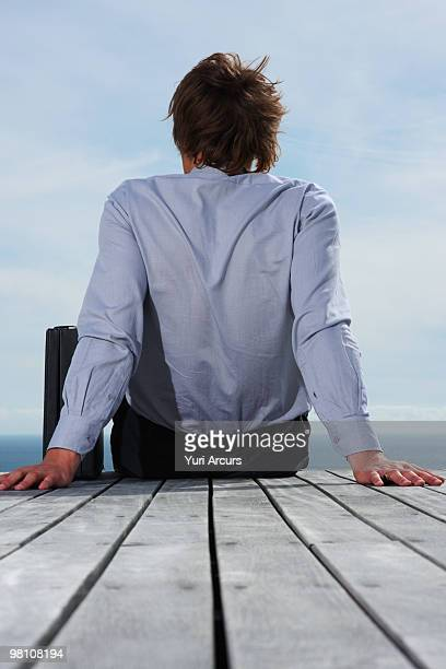Rear view of a relaxed business man sitting
