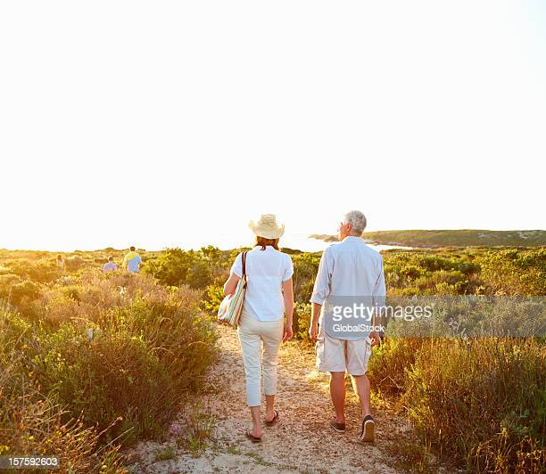 Rear view of a retired couple walking together