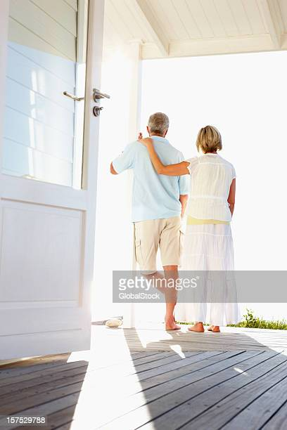 Rear view of a romantic couple at beach house