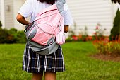 Rear view of a schoolgirl carrying a schoolbag