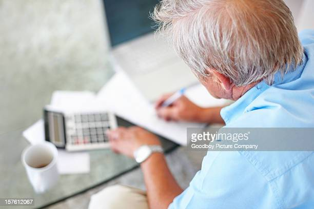 Rear view of a senior man calculating financial budget