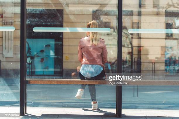Rear view of a student at the bus shelter
