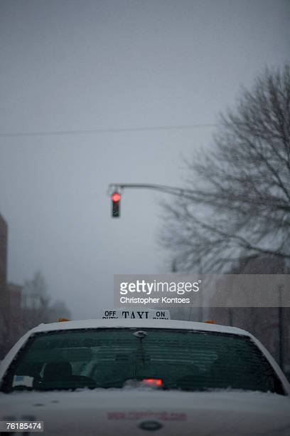 Rear view of a taxi stopped at a red traffic light