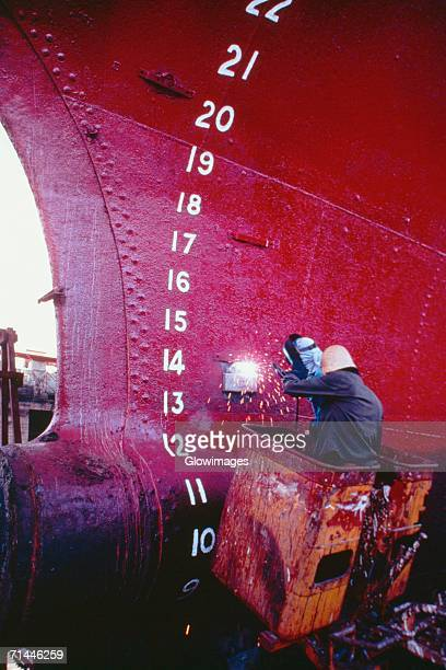 Rear view of a welder welding a tanker, Cebu, Philippines