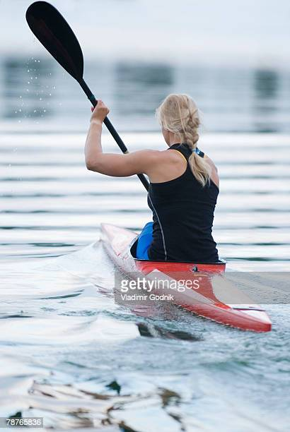 Rear view of a woman kayaking