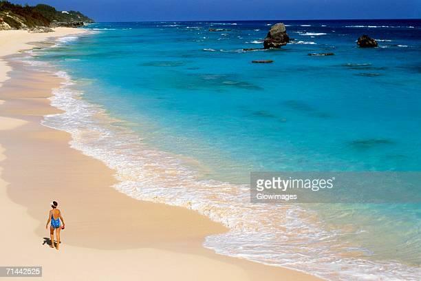 Rear view of a woman on Secret beaches, Bermuda