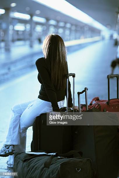 Rear view of a woman waiting at a railroad station platform, Rome, Italy