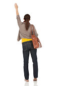 Rear view of a woman waving her hand