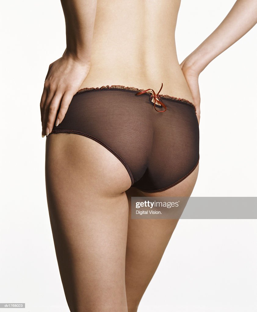 Rear View of a Woman Wearing Knickers : Stock Photo