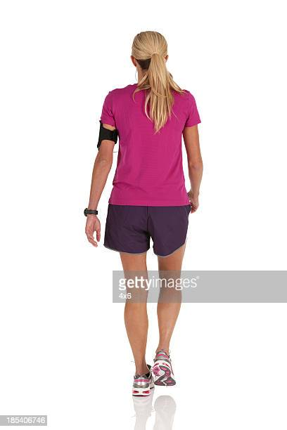 Rear view of a woman with Mp3 player on her arm