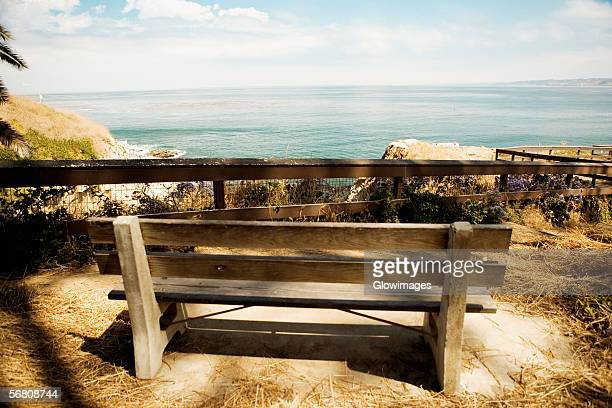 Rear view of a wooden bench on a waterfront, La Jolla, San Diego, California, USA