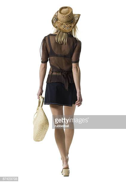 Rear view of a young woman carrying a hand bag