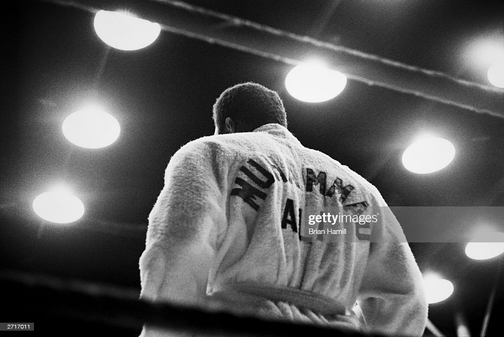 Rear view of American boxer <a gi-track='captionPersonalityLinkClicked' href=/galleries/search?phrase=Muhammad+Ali+-+Boxer+-+Born+1942&family=editorial&specificpeople=93853 ng-click='$event.stopPropagation()'>Muhammad Ali</a>, formerly Cassius Clay, wearing a robe in the boxing ring, San Juan, Puerto Rico.