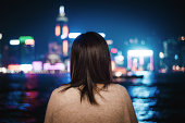 Rear view of Asian female looking at city skyline