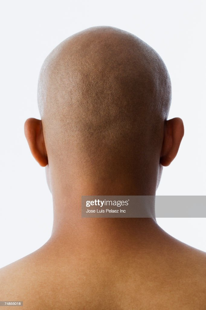 Rear view of bald Hispanic man : Stock Photo