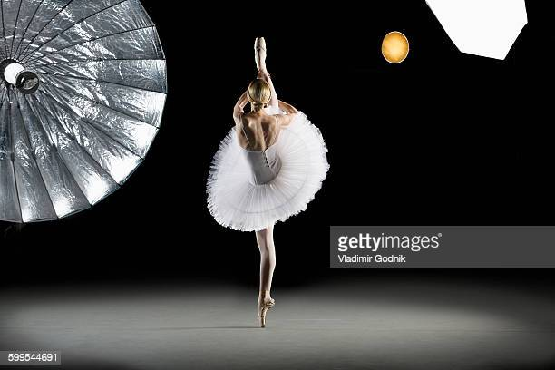 Rear view of ballerina performing at studio