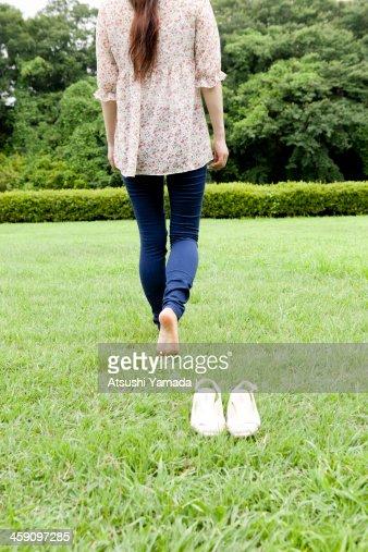 woman walking in grass - photo #18