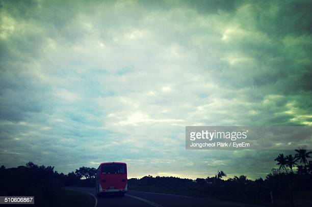 Rear view of bus on road along landscape