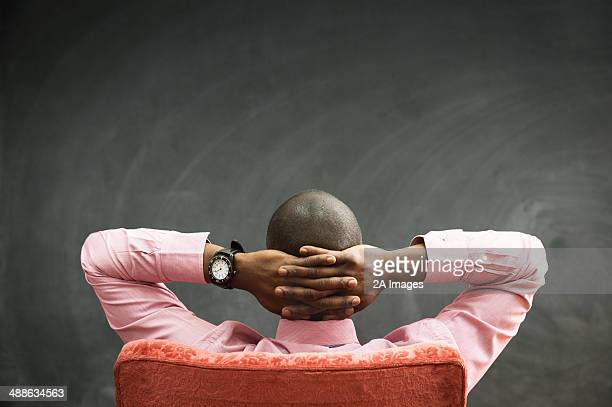Rear view of businessman as he stares at blackboard in Johannesburg, Gauteng, South Africa