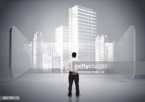 Rear view of businessman looking at holographic city : Stock-Foto